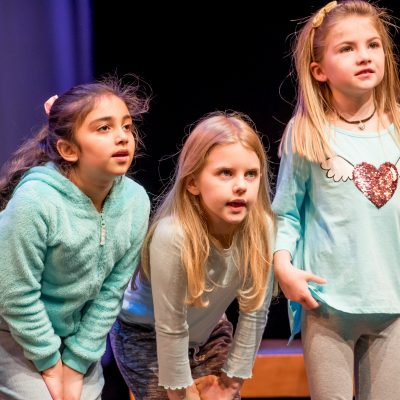 Youth theater arts education students attentively listen during a KIDSTAGE class in Everett.