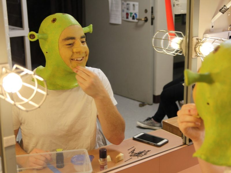 "A KIDSTAGE student gets into costume for ""Shrek the Musical."" Youth auditions are offered several times per year."